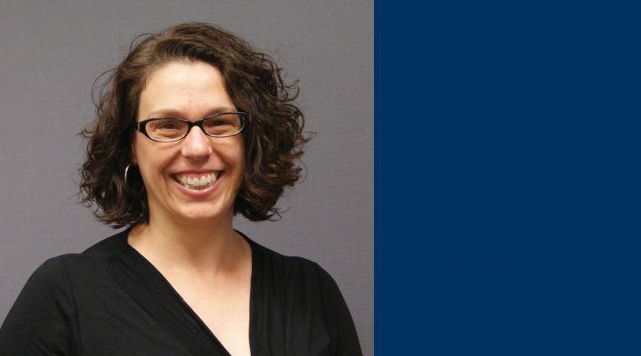Kathleen Ryan Headshot with blue background
