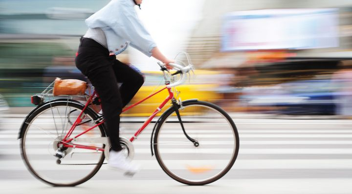 Bicyclist and colorful blurry background