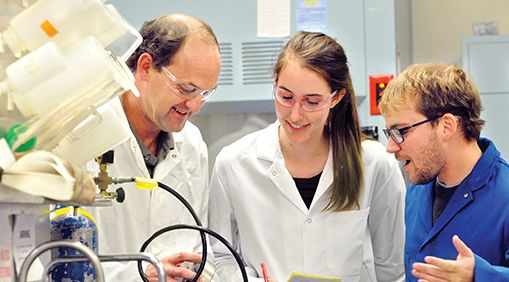 Photo of David Ackerly and students in a lab.