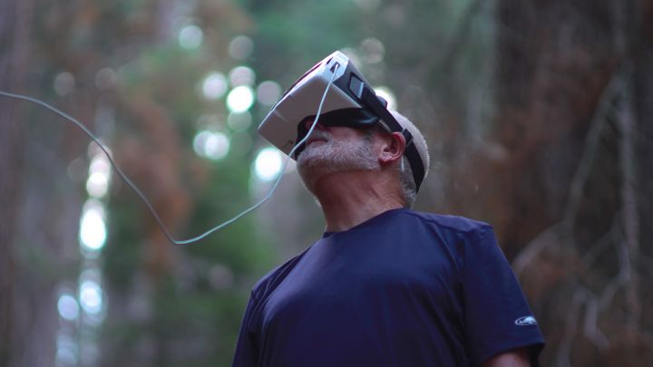 Researcher looking into a VR headset to see images captured by a drone