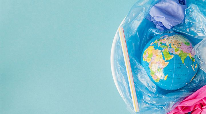 An artistic photo of a globe in the trash