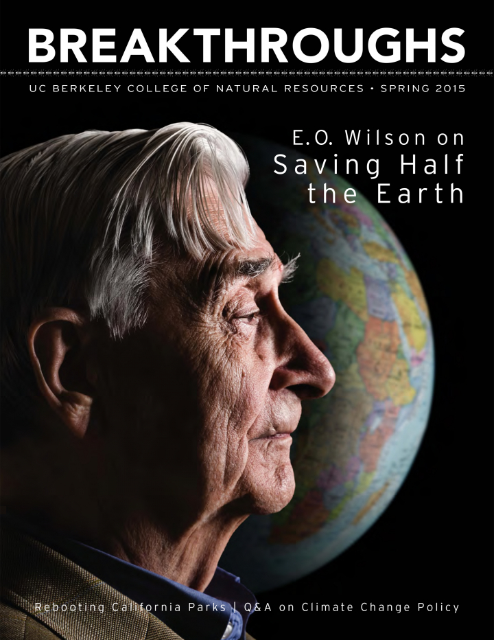 Cover of Breakthroughs Spring 2015, shows a profile of E. O. Wilson against a backdrop of the earth
