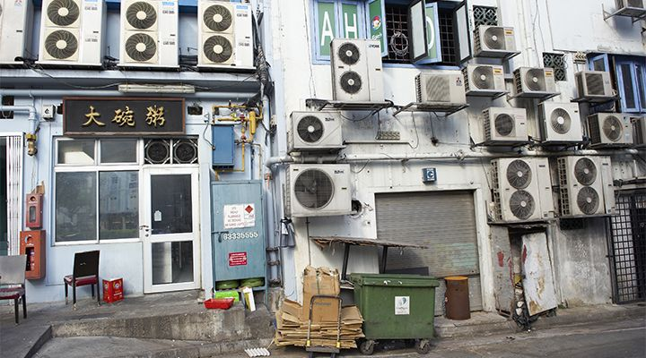 An image of air conditioners on a building in Asia
