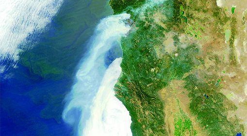 Overhead shot of fighting fire along the California coast