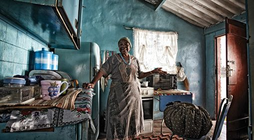 A Soweto, South Africa, customer of Wonderbag, a heat-retention device that continues to cook food after it's removed from the stove, saving users water, fuel, and time.