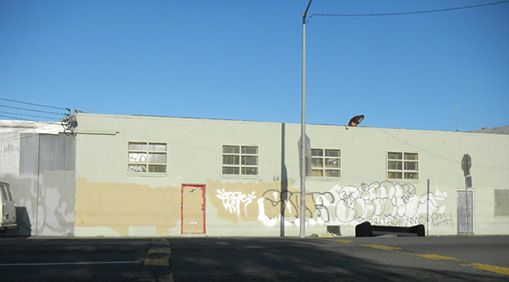 A block of Adeline Street near 53rd Street in Oakland is completely paved and has no trees or greenery.